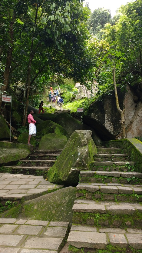 Climbing to Edakkal Caves