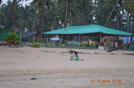 Doing yoga on beach
